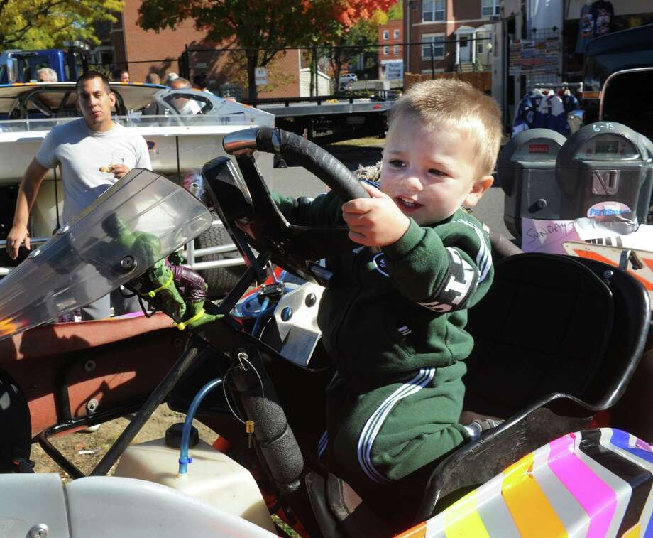 "Jake Ferrante, 2, sits behind the wheel of a go-kart during a "" Classic Car & Bike Show on Main Street""  takes place in Danbury, Conn. Sunday, Oct. 20, 2013. In the tradition of previous ""Karing for Kelly"" events, the charity event is hosted by Lew Lombardo's Ultimate Restorations LLC, and George Korres's Nico's Pizza and Pasta, to benefit Danbury firefighter Joe LaDuca, who is suffering malignant brain tumors. Photo: Michael Duffy / The News-Times"