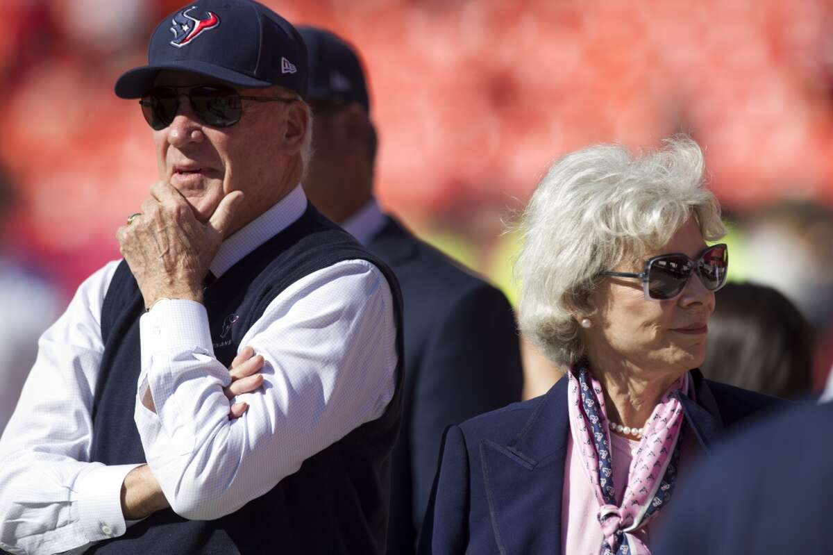 Texans owner Bob McNair and his wife Janice watch the team warm up before facing the Chiefs.