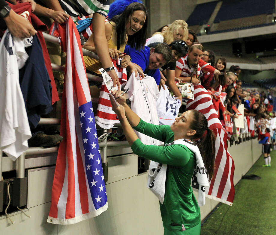 United States of America's Hope Solo signs autographs after an international friendly soccer match against Australia Sunday Oct. 20, 2013 at the Alamodome. The USA won 4-0. Photo: Edward A. Ornelas, San Antonio Express-News / © 2013 San Antonio Express-News