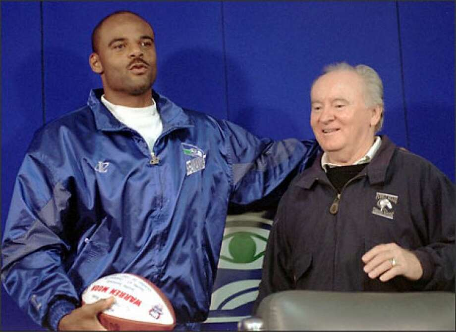 Don James with former UW quarterback Warren Moon. Photo: The Associated Press