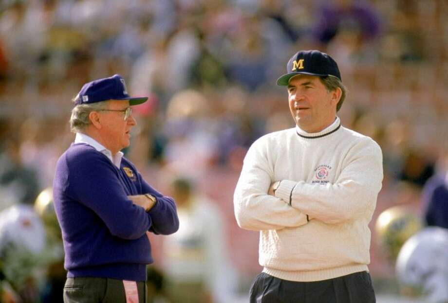 Head coach Don James of the Washington Huskies talks to head coach Gary Moeller of the Michigan Wolverines before the 1992 Rose Bowl in Pasadena, Calif. The Huskies defeated the Wolverines 34-14. Photo:  Bernstein Associates, Getty Images