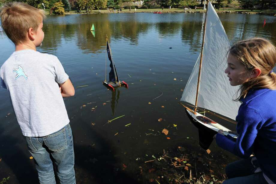 Ella Collin watch her sailboat with another boy, at Old Greenwich- Riverside Civic Center's 51st annual Model Saiboat Regatta in Binney Park, Conn., Sunday, Oct. 20, 2013. Photo: Helen Neafsey / Greenwich Time