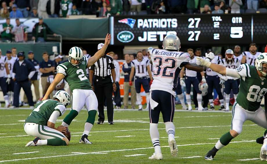 Given new life by a penalty enforced for the first time in NFL history, Nick Folk kicks the overtime field goal that dealt the Patriots a rare AFC East defeat. Photo: Ron Antonelli, Getty Images