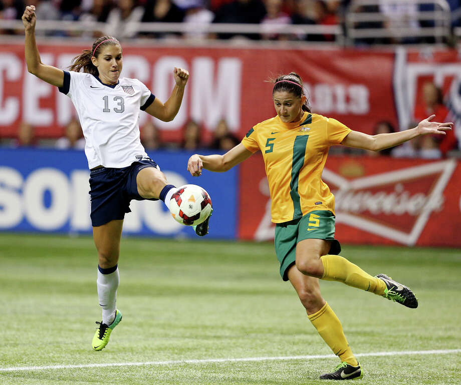 United States of America's Alex Morgan and Australia's Laura Alleway go after the ball during second half action of an international friendly soccer match Sunday Oct. 20, 2013 at the Alamodome. The USA won 4-0. Photo: Edward A. Ornelas, San Antonio Express-News / © 2013 San Antonio Express-News