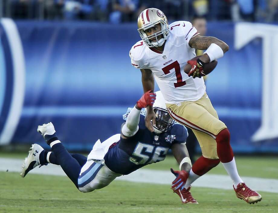 San Francisco 49ers quarterback Colin Kaepernick (7) gets past Tennessee Titans linebacker Akeem Ayers (56) during the second half of an NFL football game on Sunday, Oct. 20, 2013, in Nashville, Tenn. (AP Photo/Wade Payne) Photo: Wade Payne, Associated Press