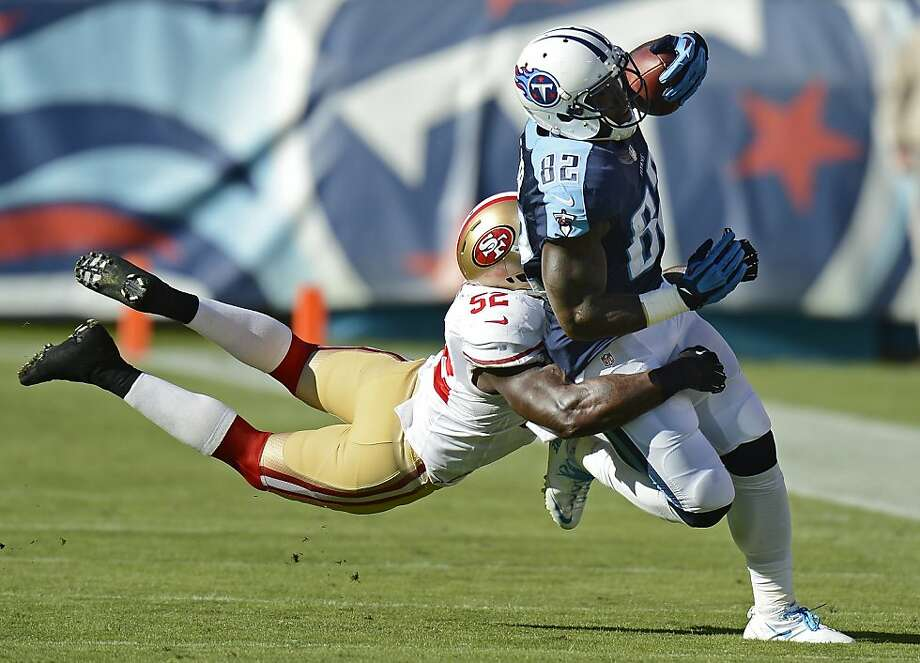 Tennessee Titans tight end Delanie Walker (82) is brought down by San Francisco 49ers linebacker Patrick Willis (52) in the first quarter of an NFL football game on Sunday, Oct. 20, 2013, in Nashville, Tenn. (AP Photo/Mark Zaleski) Photo: Mark Zaleski, Associated Press