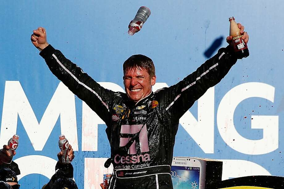 Jamie McMurray celebrates after his first NASCAR Sprint Cup Series victory since 2010. Photo: Chris Graythen, Getty Images
