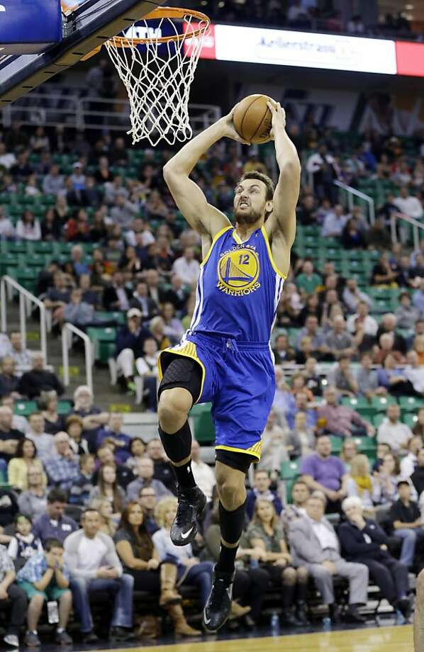 Andrew Bogut, who played less than three minutes in the Warriors' exhibition game Friday, was able to practice Sunday. Photo: Rick Bowmer, Associated Press