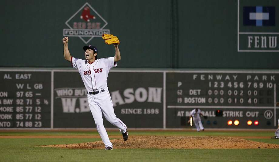Boston's Koji Uehara starts the celebration after striking out Detroit's Jose Iglesias to end the ALCS on Saturday night. Photo: Tim Donnelly, Associated Press