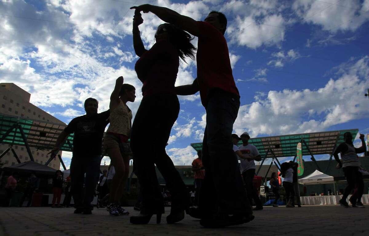 An unidentified couple dances during El Festival De La Salsa at Jones Plaza on Sunday, Oct. 20, 2013, in Houston.