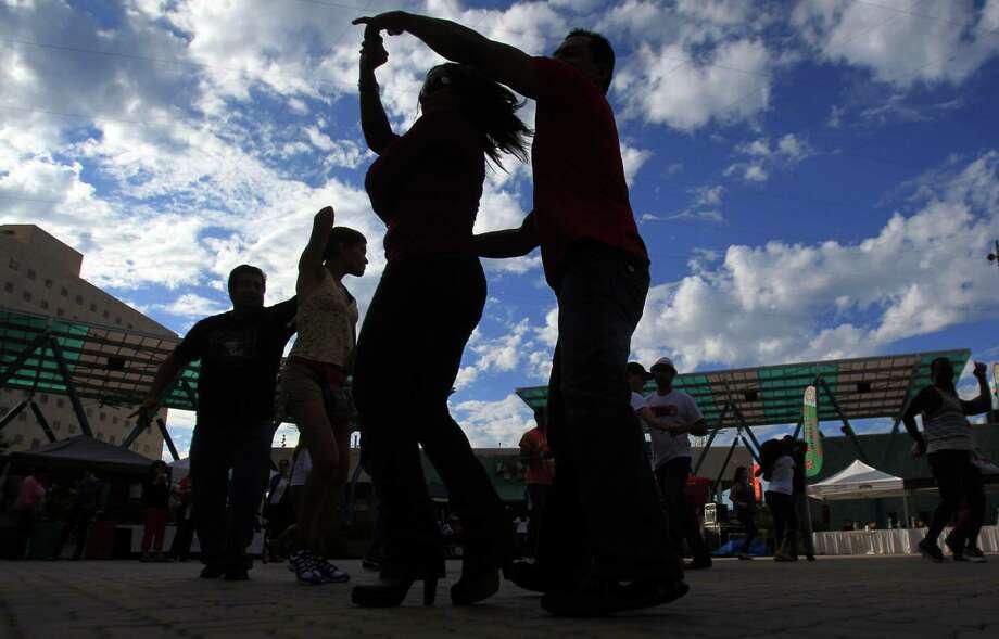 An unidentified couple dances during El Festival De La Salsa at Jones Plaza on Sunday, Oct. 20, 2013, in Houston. Photo: Mayra Beltran, Houston Chronicle / © 2013 Houston Chronicle