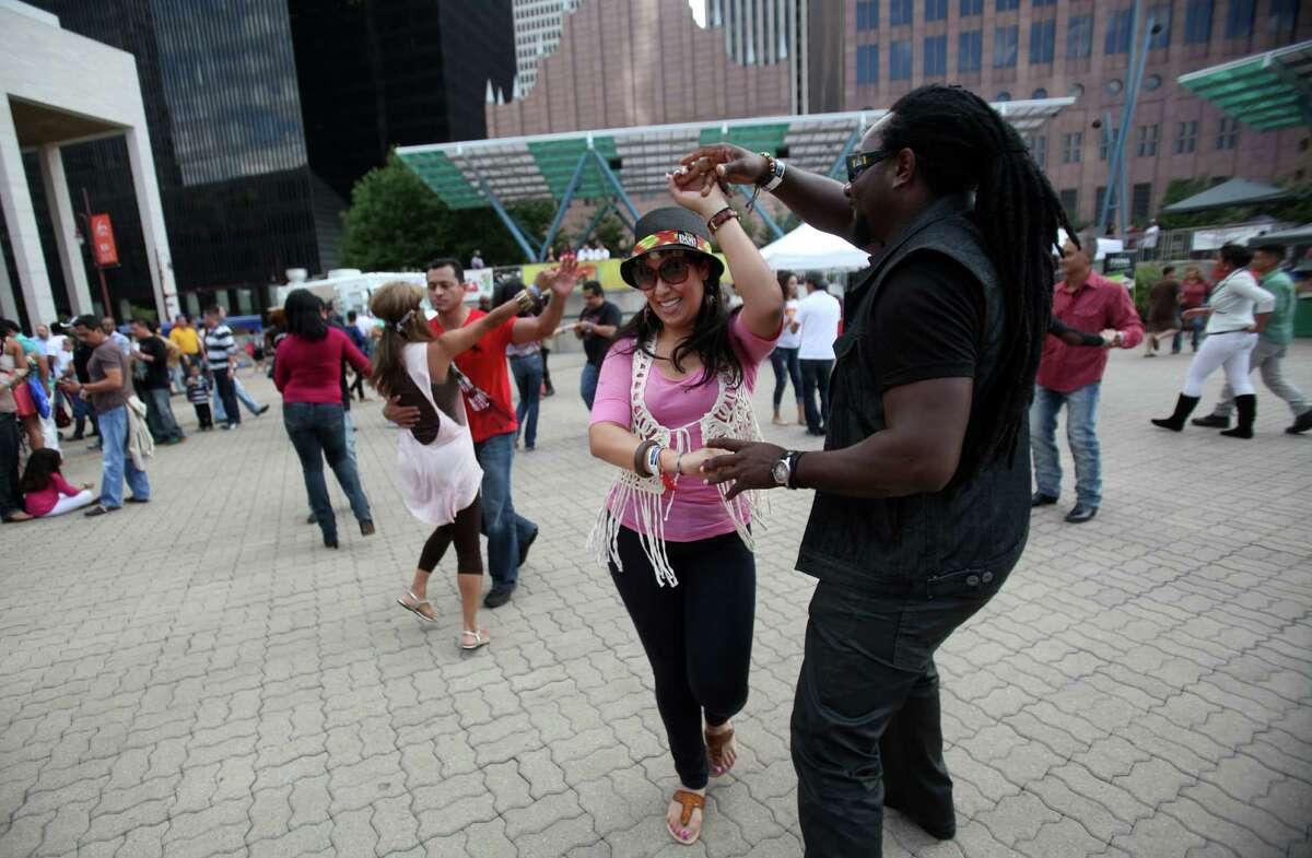 Clarissa Obregon and Lorenzo Ibell dance salsa during El Festival De La Salsa at Jones Plaza on Sunday, Oct. 20, 2013, in Houston.