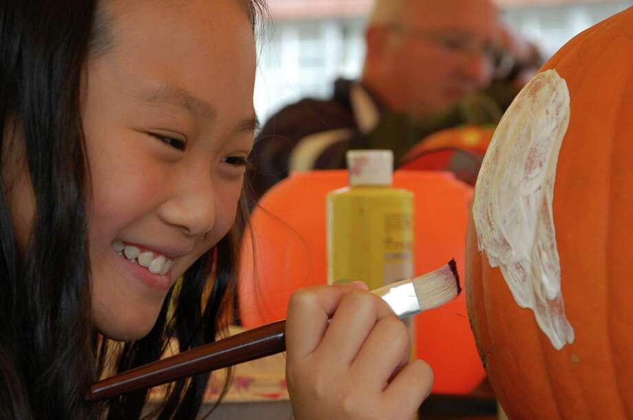 "Raeyna Chang, 10, of Norwalk, said she likes the idea of ""expressing yourself on a pumpkin"" at Saturday's pumpkin decorating hosted by Old Well-St. Johnís Masonic Lodge. Photo: Jarret Liotta / Norwalk Citizen contributed"