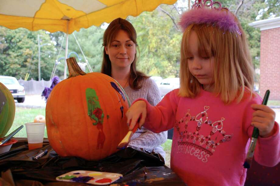 Charlotte Hair, 3, worked on decorating a second pumpkin after finishing another at Saturday's decorating event Old Well-St. Johnís Masonic Lodge. Photo: Jarret Liotta / Norwalk Citizen contributed