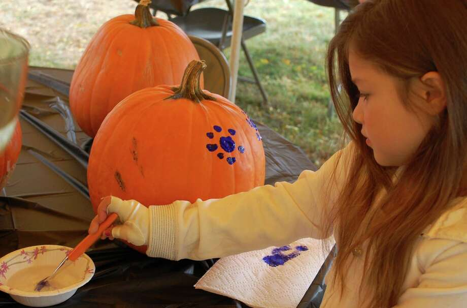 Angelina Ribeiro, 7, of Norwalk, decided to put polka dots on her pumpkin at Old Well-St. Johnís Masonic Lodge on Saturday. Photo: Jarret Liotta / Norwalk Citizen contributed
