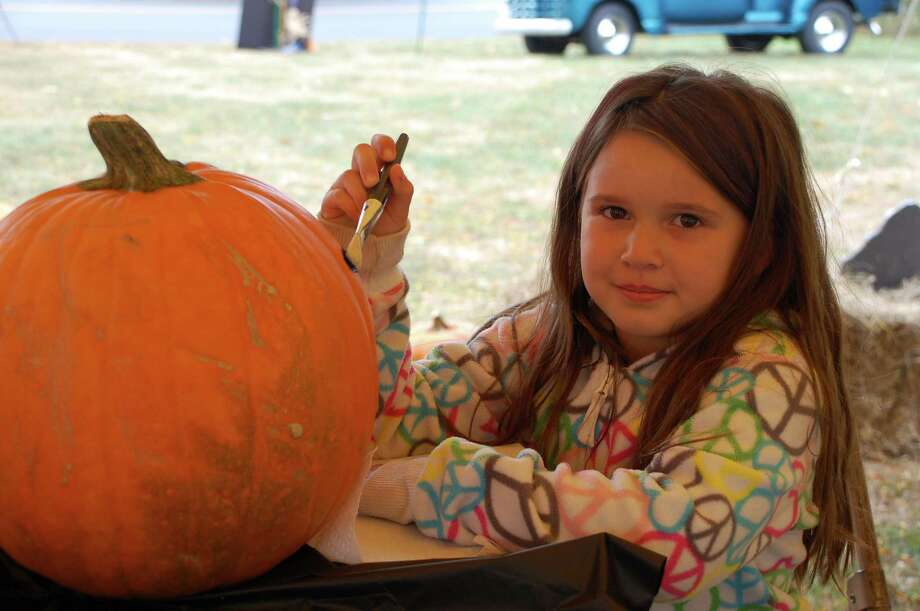 Jasmine Ribeiro, 6, of Norwalk, said she was inspired by decorating pumpkins Saturday at Old Well-St. Johnís Masonic Lodge. Photo: Jarret Liotta / Norwalk Citizen contributed