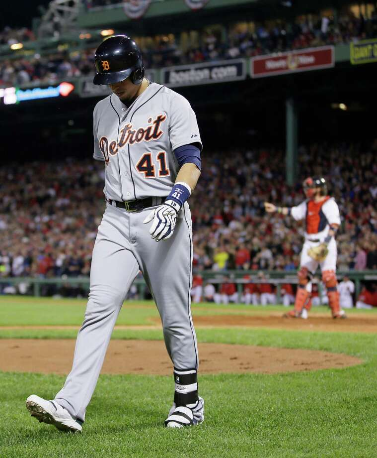 Detroit Tigers' Victor Martinez walks to the dugout after striking out in the eighth inning during Game 6 of the American League baseball championship series against the Boston Red Sox on Saturday, Oct. 19, 2013, in Boston. The Red Sox won 5-2 to advance to the World Series. (AP Photo/Matt Slocum) ORG XMIT: ALCS278 Photo: Matt Slocum / AP