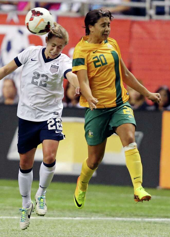 United States of America's Meghan Klingenberg and  Australia's Samantha Kerr go up for a header during second half action of an international friendly soccer match Sunday Oct. 20, 2013 at the Alamodome. The USA won 4-0. Photo: Edward A. Ornelas, San Antonio Express-News / © 2013 San Antonio Express-News