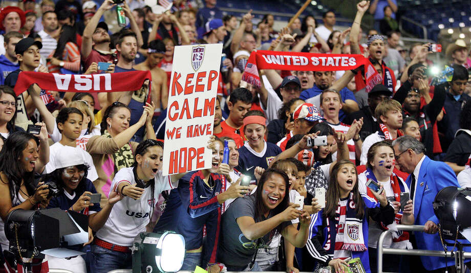United States of America soccer fans cheer for Hope Solo (not pictured) after an international friendly soccer match with Australia during second half action of  Sunday Oct. 20, 2013 at the Alamodome. The USA won 4-0. Photo: Edward A. Ornelas, San Antonio Express-News / © 2013 San Antonio Express-News