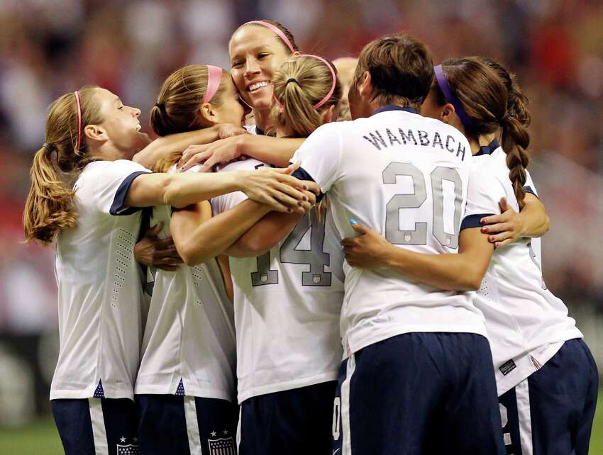United States of America's Lauren Holiday (center) celebrates with teammates after scoring a goal against Australia during first half action of an international friendly soccer match Sunday Oct. 20, 2013 at the Alamodome.