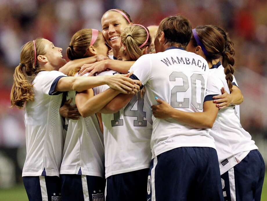 United States of America's Lauren Holiday (center) celebrates with teammates after scoring a goal against Australia during first half action of an international friendly soccer match Sunday Oct. 20, 2013 at the Alamodome. Photo: Edward A. Ornelas, San Antonio Express-News / © 2013 San Antonio Express-News