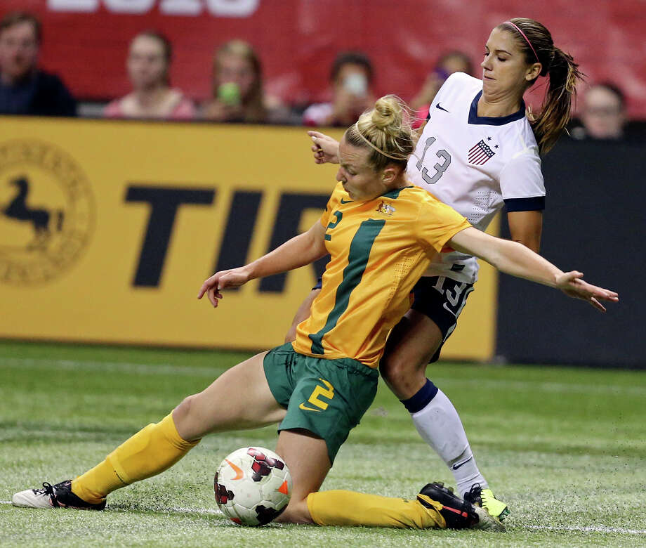 Australia's Teigen Allen and United States of America's Alex Morgan chase after the ball during second half action of an international friendly soccer match Sunday Oct. 20, 2013 at the Alamodome. The USA won 4-0. Photo: Edward A. Ornelas, San Antonio Express-News / © 2013 San Antonio Express-News