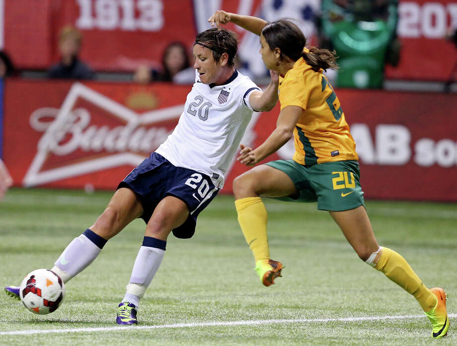 United States of America's Abby Wambach and Australia's Samantha Kerr struggle for control of the ball during second half action of an international friendly soccer match Sunday Oct. 20, 2013 at the Alamodome. The USA won 4-0. Photo: Edward A. Ornelas, San Antonio Express-News / © 2013 San Antonio Express-News