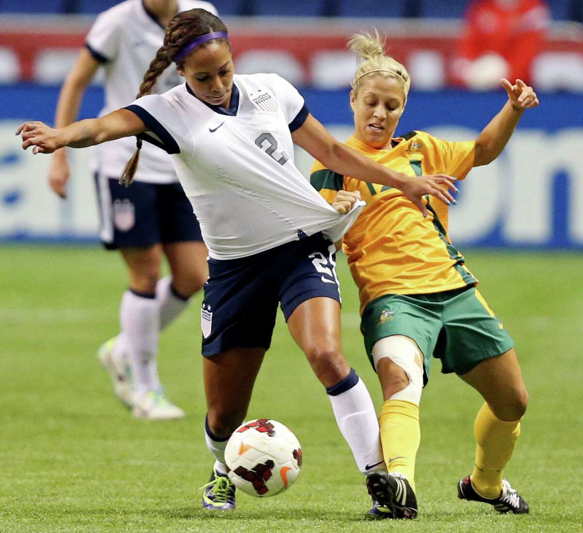 United States of America's Sydney Leroux and Australia's Katrina Gorry battle for control of the ball during first half action of an international friendly soccer match Sunday Oct. 20, 2013 at the Alamodome.