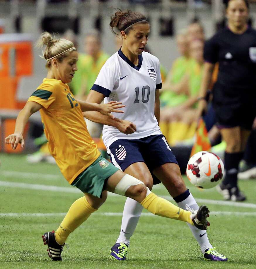 Australia's Katrina Gorry and United States of America's Carli Lloyd go after the ball during first half action of an international friendly soccer match Sunday Oct. 20, 2013 at the Alamodome. Photo: Edward A. Ornelas, San Antonio Express-News / © 2013 San Antonio Express-News