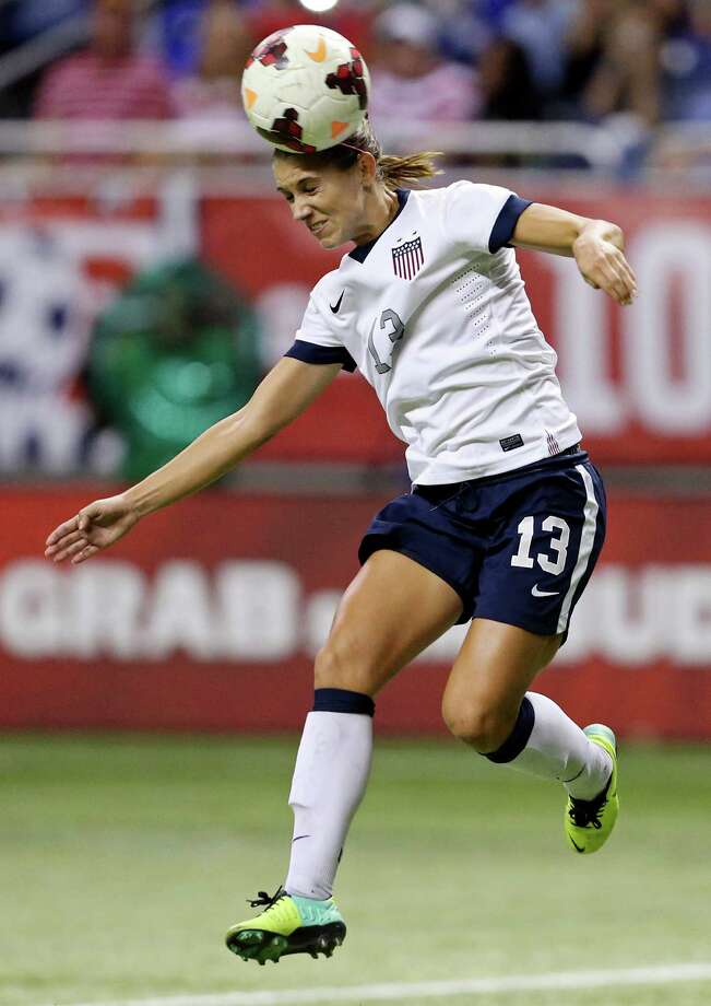 United States of America's Alex Morgan heads the ball during second half action of an international friendly soccer match against Australia Sunday Oct. 20, 2013 at the Alamodome. The USA won 4-0. Photo: Edward A. Ornelas, San Antonio Express-News / © 2013 San Antonio Express-News