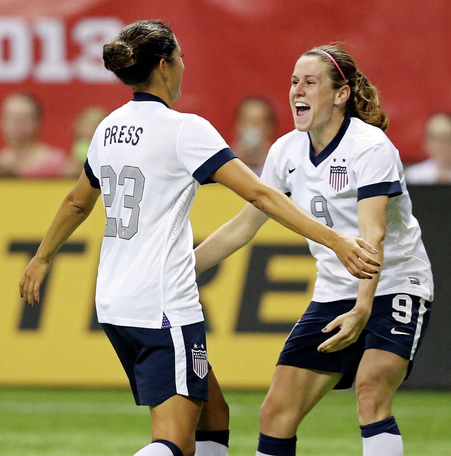United States of America's Christen Press (left) celebrates with teammate Heather O'Reilly after scoring a goal during second half action of an international friendly soccer match against Australia Sunday Oct. 20, 2013 at the Alamodome. The USA won 4-0. Photo: Edward A. Ornelas, San Antonio Express-News / © 2013 San Antonio Express-News