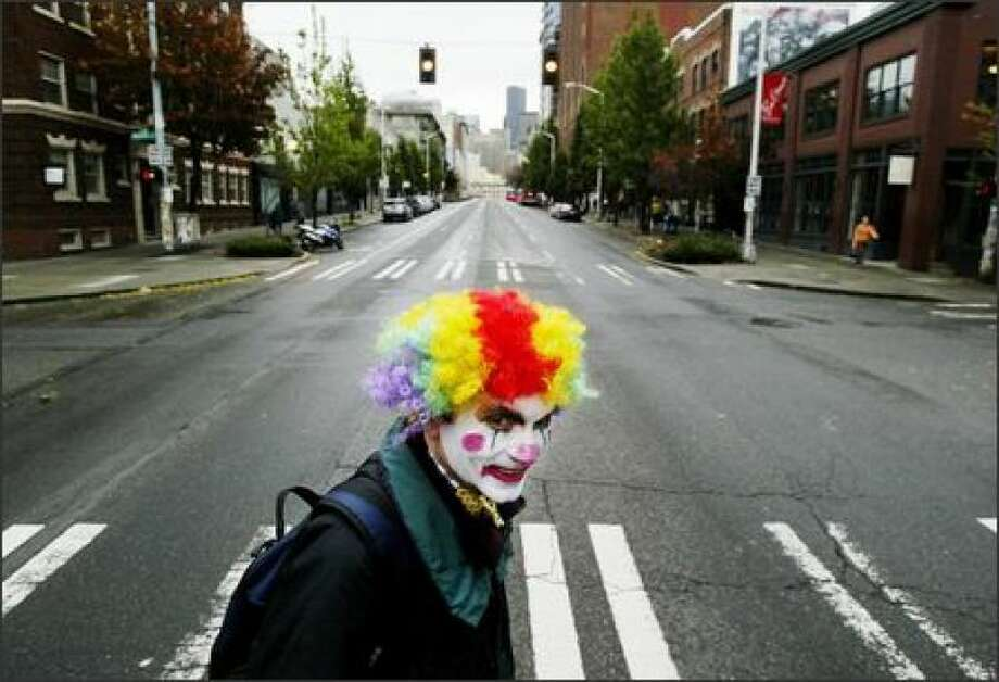 File photo - Just a creepy clown walking to work on Second Avenue in Seattle. (Larry Hohm is pictured in 2005 in his Halloween outfit). Photo: Dan DeLong, Seattle Post-Intelligencer / Seattle Post-Intelligencer