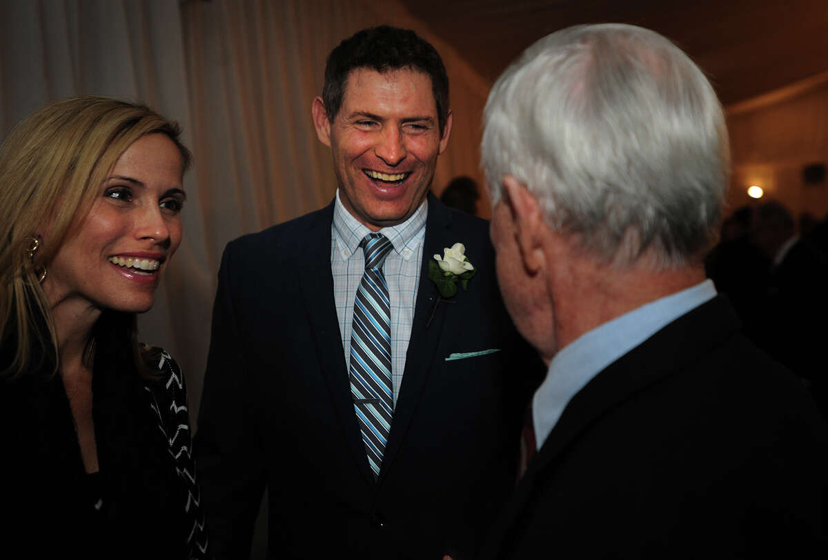 From left; Barb Young and husband and NFL Hall of Famer Steve Young have a laugh with Young's high school football coach Mike Ornato at the Greenwich High School Sports Hall of Fame Induction Ceremony at the Hyatt Regency Hotel in Greenwich, Conn. on Sunday, October 20, 2013.