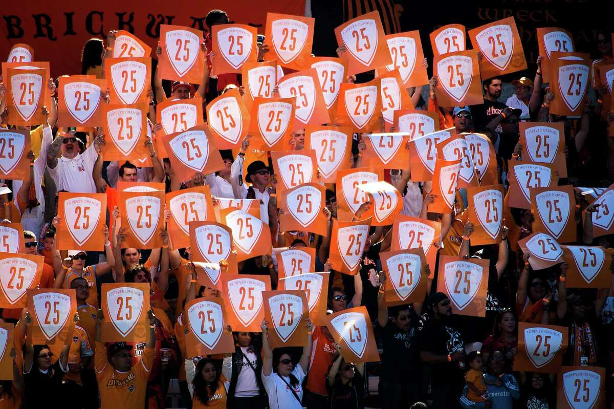 Dynamo fans hold up signs in support of forward Brian Ching during the 25th minute.