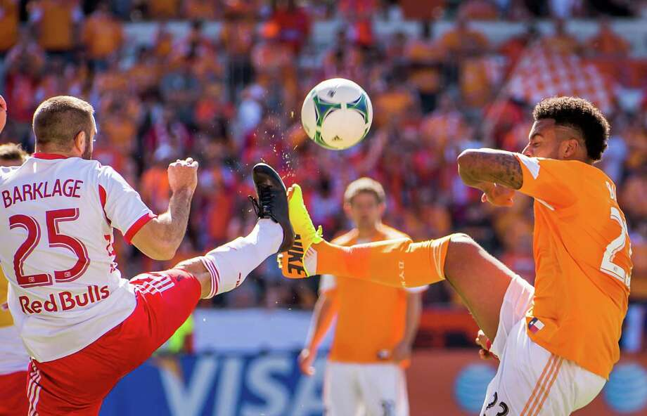 Dynamo midfielder Boniek Garcia, right, fights for the ball against Red Bulls midfielder Brandon Barklage. Photo: Smiley N. Pool, Houston Chronicle / © 2013  Houston Chronicle