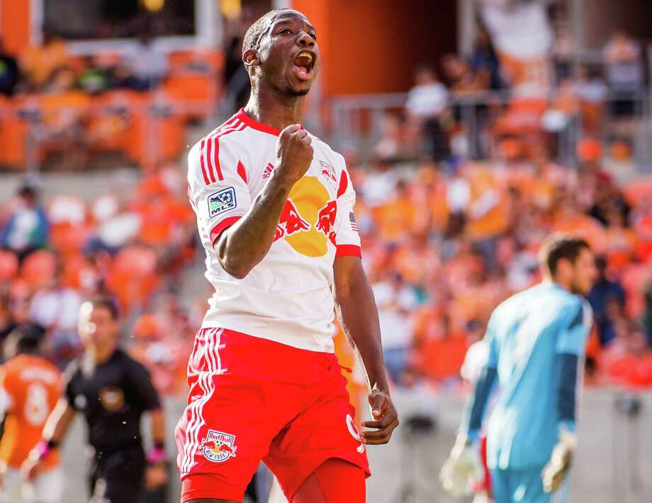 Red Bulls forward Bradley Wright-Phillips celebrates after scoring on Dynamo goalkeeper Tally Hall, right, during 65th minute. Photo: Smiley N. Pool, Houston Chronicle / © 2013  Houston Chronicle