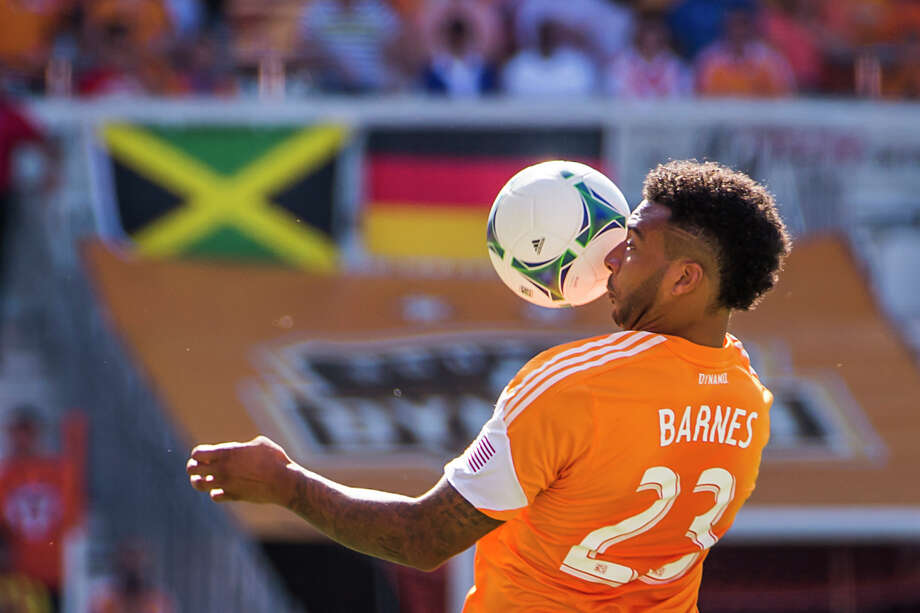 Dynamo midfielder Giles Barnes goes up for a header. Photo: Smiley N. Pool, Houston Chronicle / © 2013  Houston Chronicle