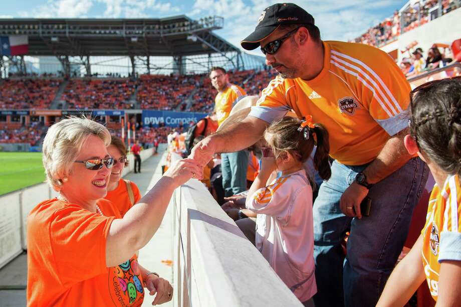 Houston mayor Annise Parker greets Dynamo fans during halftime. Photo: Smiley N. Pool, Houston Chronicle / © 2013  Houston Chronicle