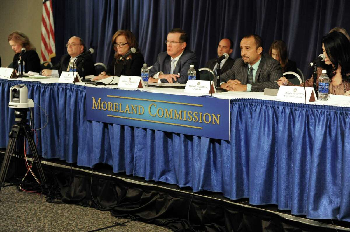 Moreland Commission members listen as Brian Paul of Common Cause speaks during the Moreland Commission to probe public corruption hearing at the Capitol on Tuesday Sept. 24, 2013 in Albany, N.Y. (Michael P. Farrell/Times Union)