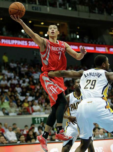 "Jeremy Lin, left, and Patrick Beverley can impact games in different ways, leading Dwight Howard to say ""it's a good problem to have two guys that are capable of coming in and making plays and starting."" Photo: Bullit Marquez, STF / AP"