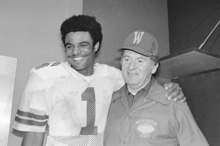 In this Jan. 2, 1978 file photo, University of Washington Huskies' Warren Moon (1) poses with coach Don James after the Rose Bowl in Pasadena. Photo: AP