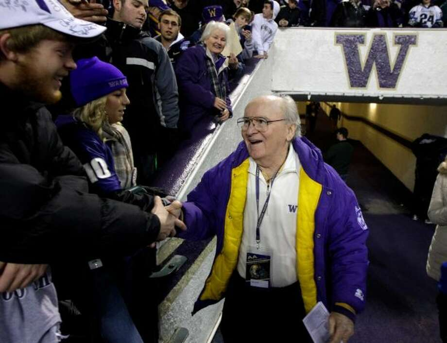 In this Nov. 5, 2011 file photo, former University of Washington football coach Don James greets fans prior to an NCAA college football game against Oregon, in Seattle. Photo: Ted S. Warren, AP