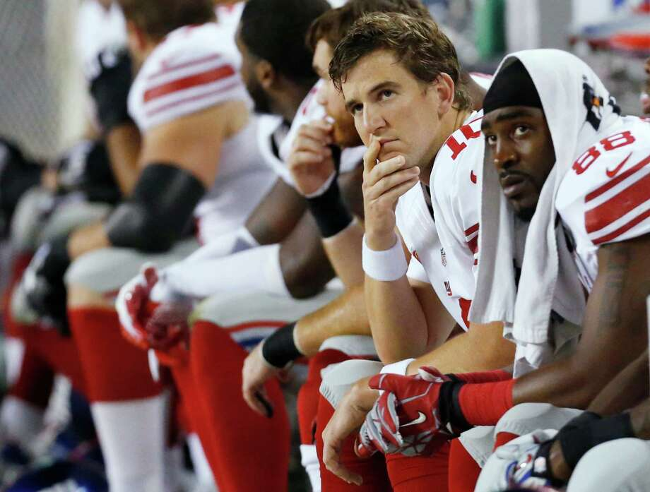 New York Giants quarterback Eli Manning (10) and wide receiver Hakeem Nicks (88) watch from the bench in the first half of an NFL football game against the Chicago Bears, Thursday, Oct. 10, 2013, in Chicago. (AP Photo/Charles Rex Arbogast) ORG XMIT: CXB167 Photo: Charles Rex Arbogast / AP