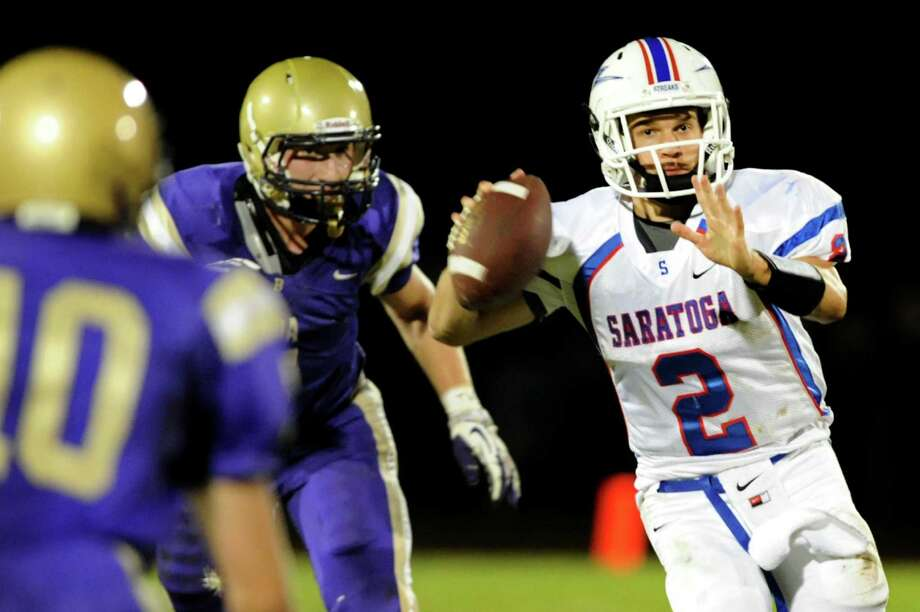 Saratoga's quarterback Jake Eglintine, right, draws back to throw a pass during their football game against CBA on Friday, Sept. 27, 2013, at Christian Brothers Academy in Colonie N.Y. (Cindy Schultz / Times Union) Photo: Cindy Schultz / 00024011A