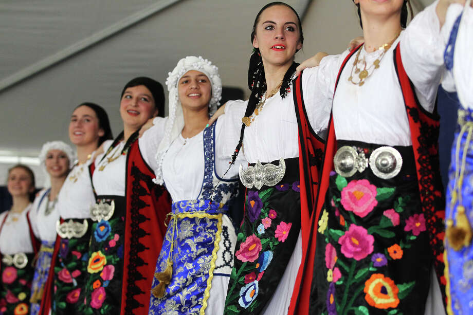 Traditional Greek dances are performs by church youth on the last day of the three-day Greek Funstival on the grounds of St. Sophia Greek Orthodox Church, Sunday, Oct. 20, 2013. Over 7,000 were expected to attend the event over the weekend. Photo: San Antonio Express-News / © 2013 San Antonio Express-News