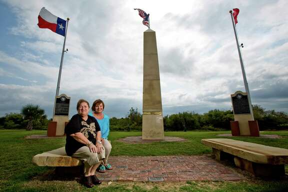 Anne Willis, left, vice president of the Bolivar Peninsula Chamber of Commerce, and Margot Johnson were instrumental in the erecting of the monument at right to Jane Long - who dubbed herself the Mother of Texas.