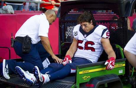 Texans inside linebacker Brian Cushing sits on a cart after he suffered both a fractured fibula and torn LCL in his left knee midway through the third quarter.
