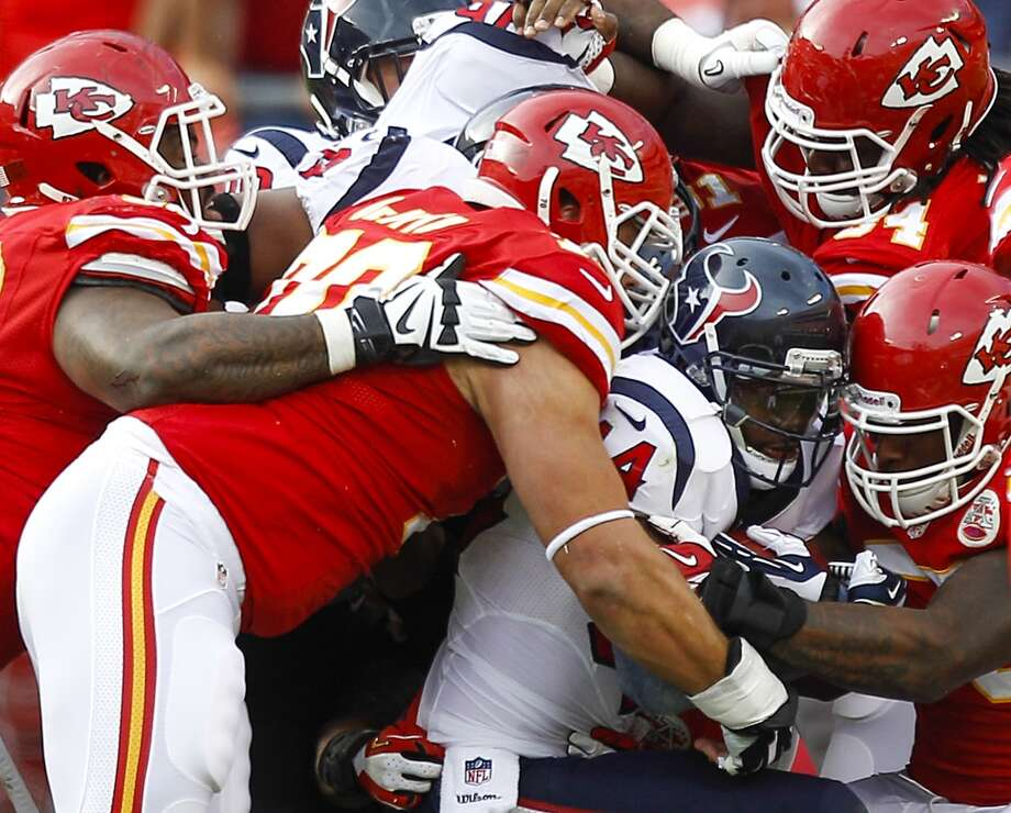 Texans running back Ben Tate is stopped at the line of scrimmage by the Chiefs defense. Photo: Brett Coomer, Houston Chronicle