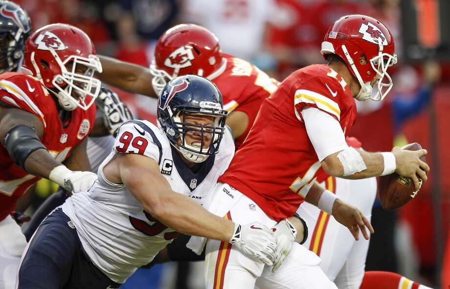 Texans defensive end J.J. Watt sacks Chiefs quarterback Alex Smith. Photo: Brett Coomer, Houston Chronicle
