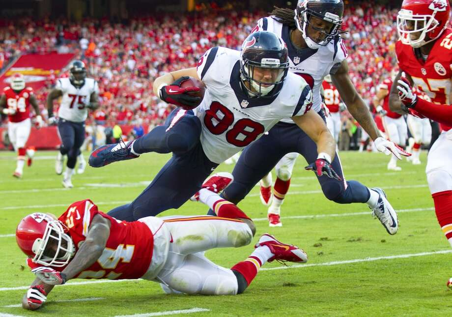 Texans tight end Garrett Graham is tripped up by Chiefs cornerback Brandon Flowers stopping him short of the goal line during the third quarter. Photo: Brett Coomer, Houston Chronicle